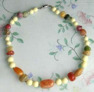 this is a pretty multi colored faux stones lucite necklace it is in