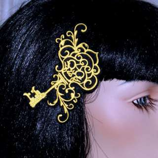 This hair clip is a big bright Skeleton Key. Its embroidered with