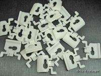 80 on Cadillac front door window moulding clips 1980