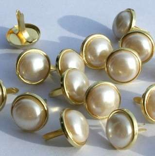 12 pieces of 12mm round white pearl brads with gold trim. Great for