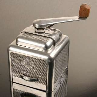 Very rare french art deco machine age designed coffee grinder. A most